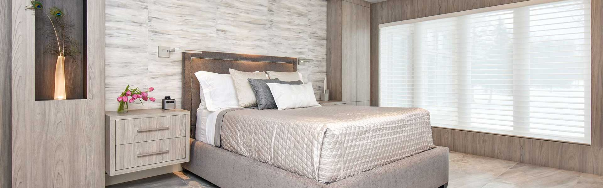 Contemporary master bedroom, large format porcelain tiles on floor, wood panelling on walls, upholstered bed flanked by contemporary wall sconces, reading lights, floating nightstands, custom cabinetry, modern bedroom, interior designer cornwall, interior designer ottawa, Master Clinic Gallery - Sheridan Interiors, sheridan interiors kitchens and baths