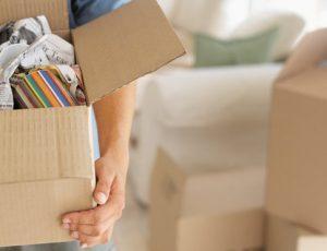 Man moving a box - Sheridan Interiors