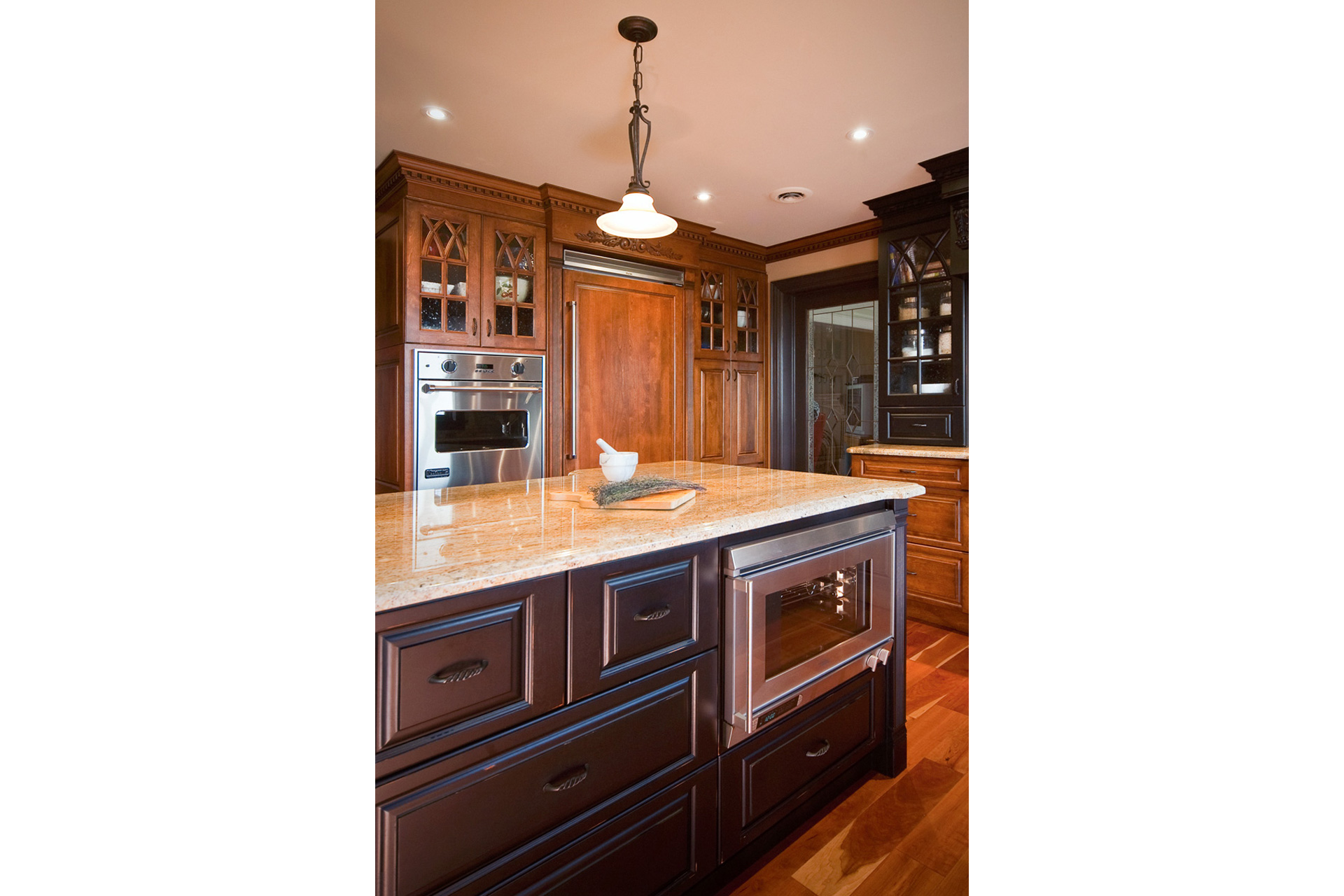 Kitchen with large black wood island - Sheridan Interiors