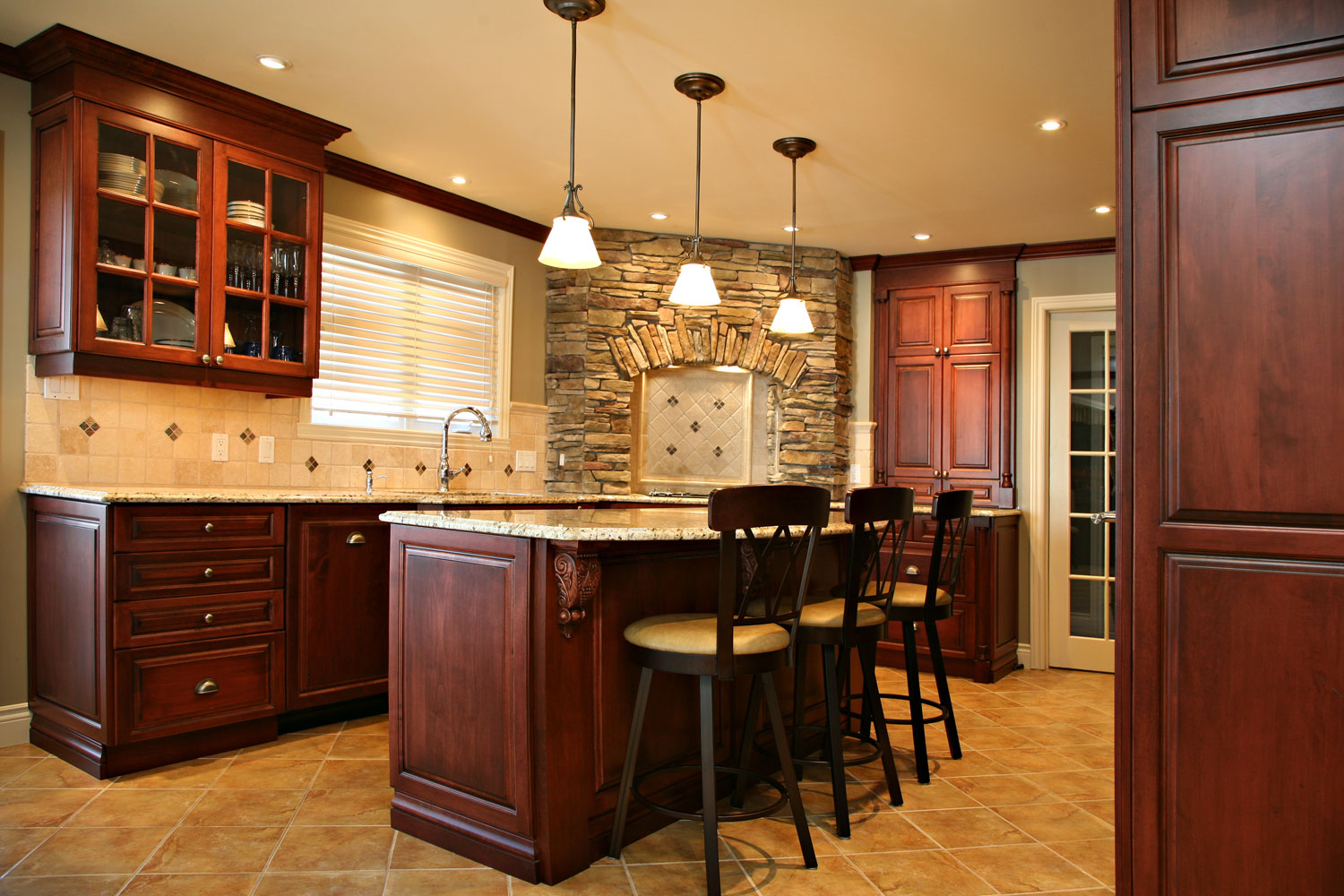 Traditional kitchen with island, corner gas cooktop with stone surround