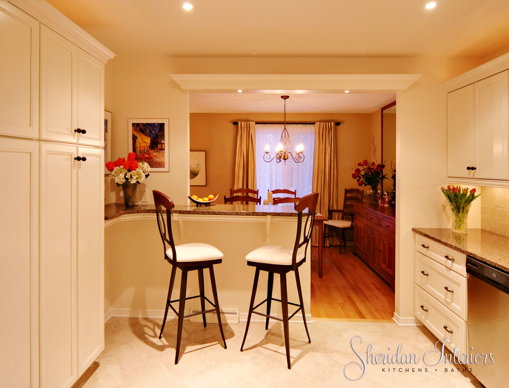 White kitchen, transitional style with breakfast bar and stools - Sheridan Interiors