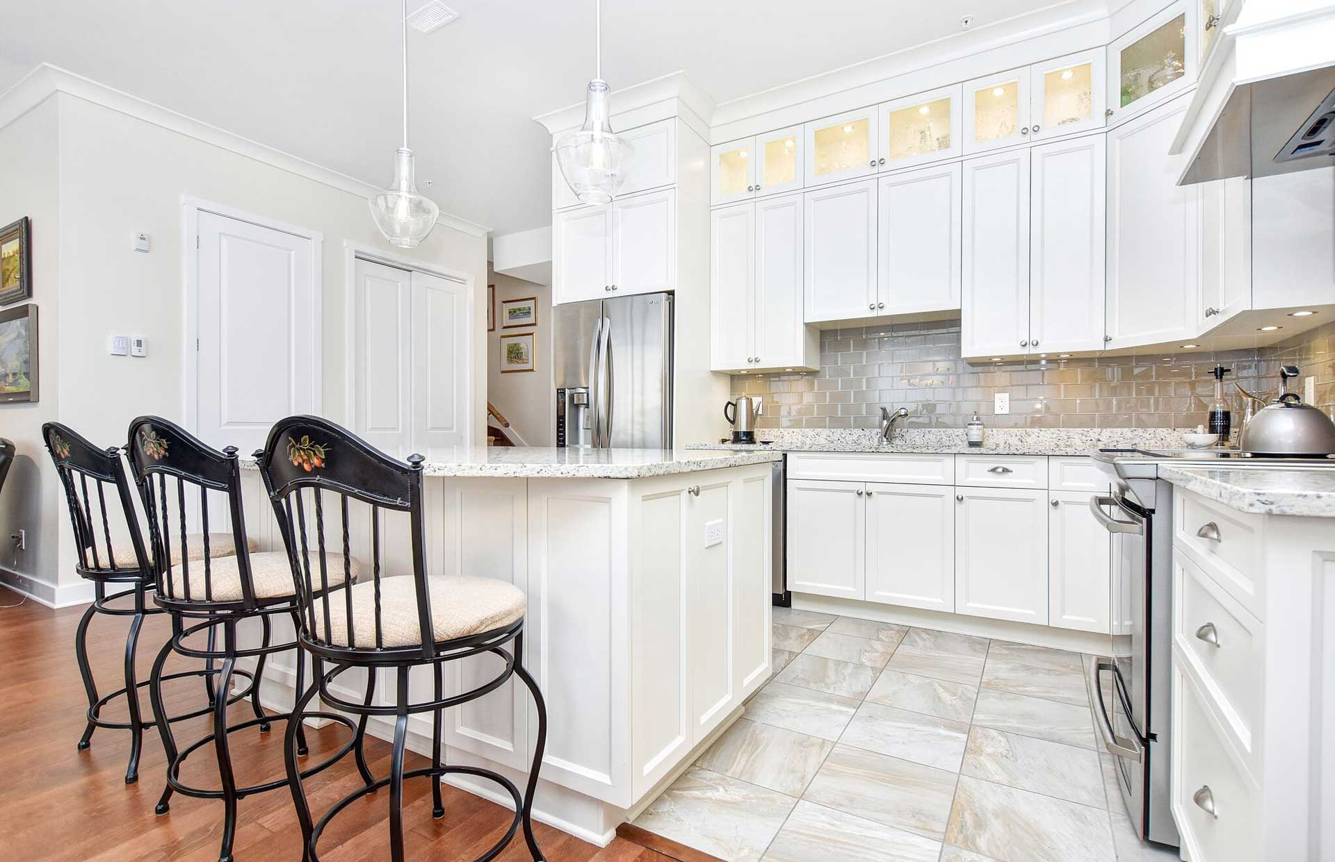condo living, condo kitchen, white kitchen, shaker cabinets