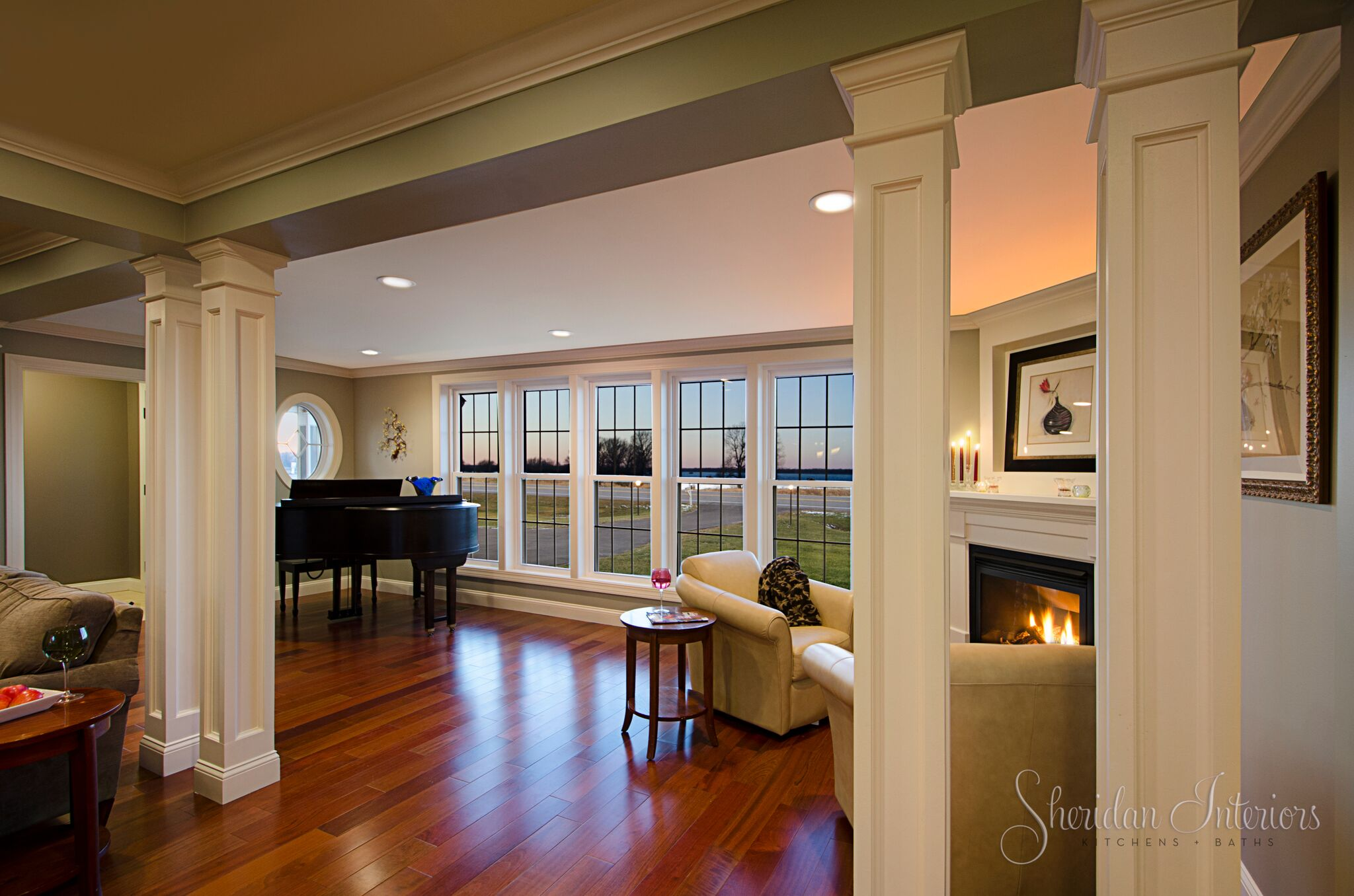 Traditional Sitting Room with Corner Gas Fireplace and Painted Mantle - Sheridan Interiors