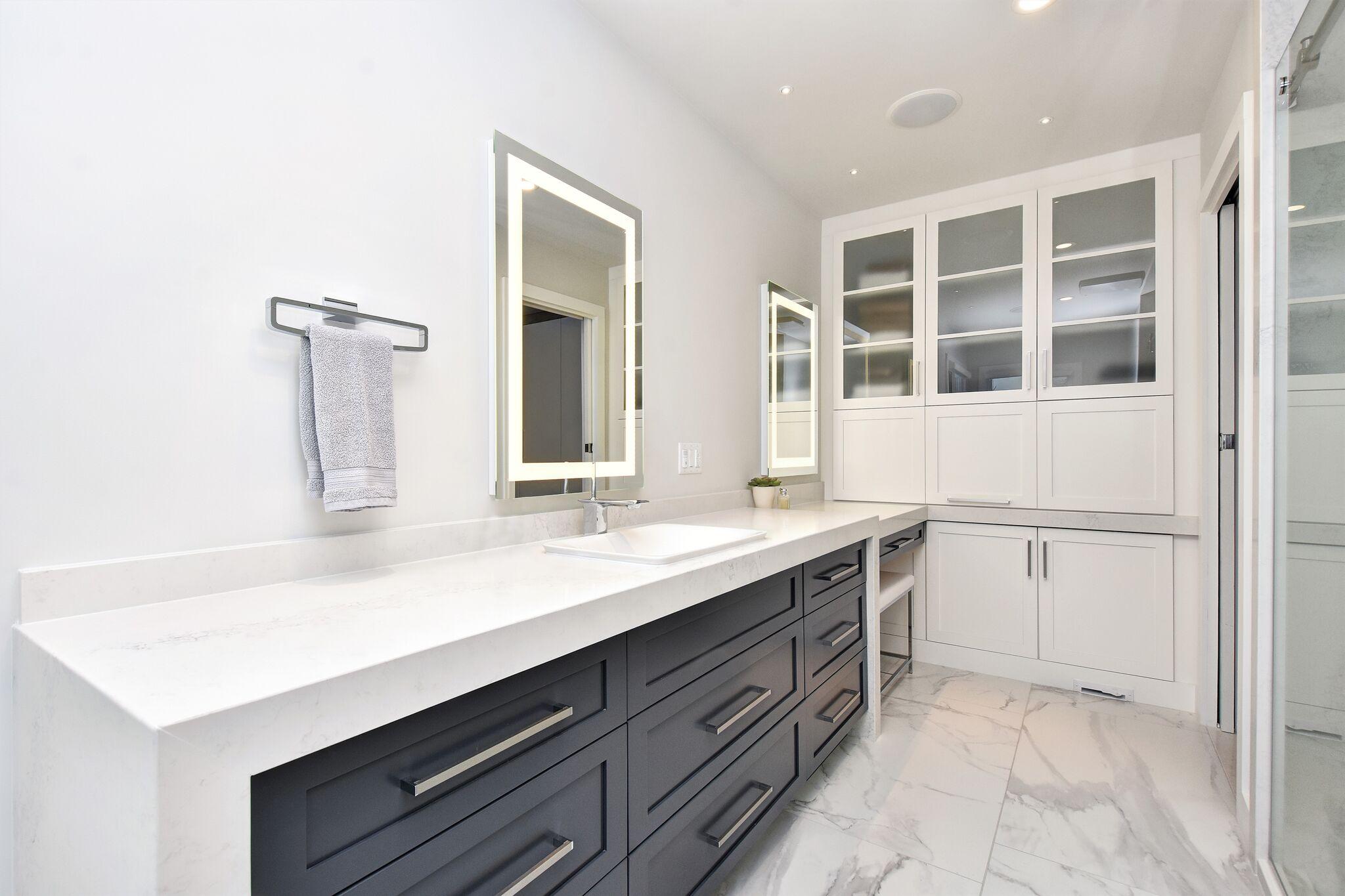 Contemporary modern bathroom, dark vanity with white top, make-up vanity