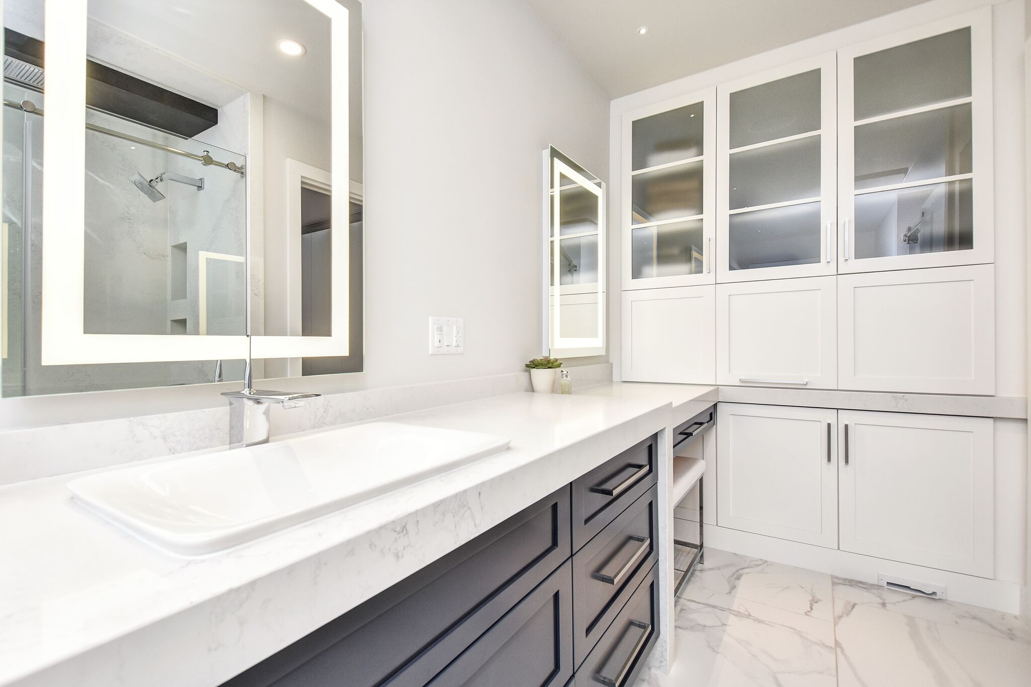 Modern master bathroom, LED Lighted mirrors, storage cabinetry in bathroom