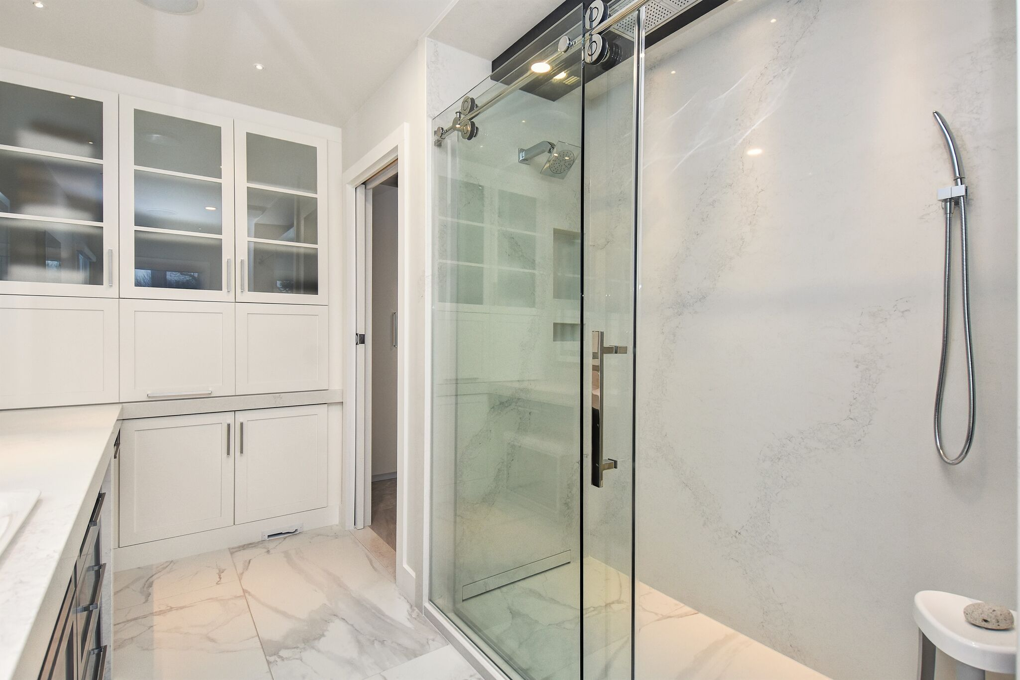 Modern master bathroom, modern walk-in shower, shower with invisible wall drain, linear drain