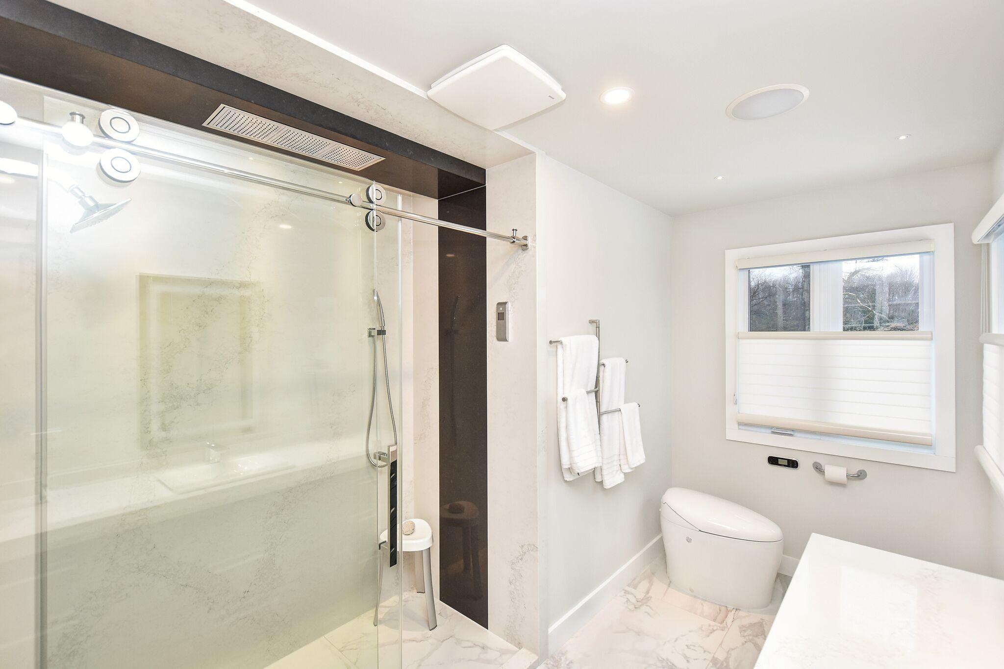 Modern master bathroom, modern walk-in shower, Kohler Karing toilet