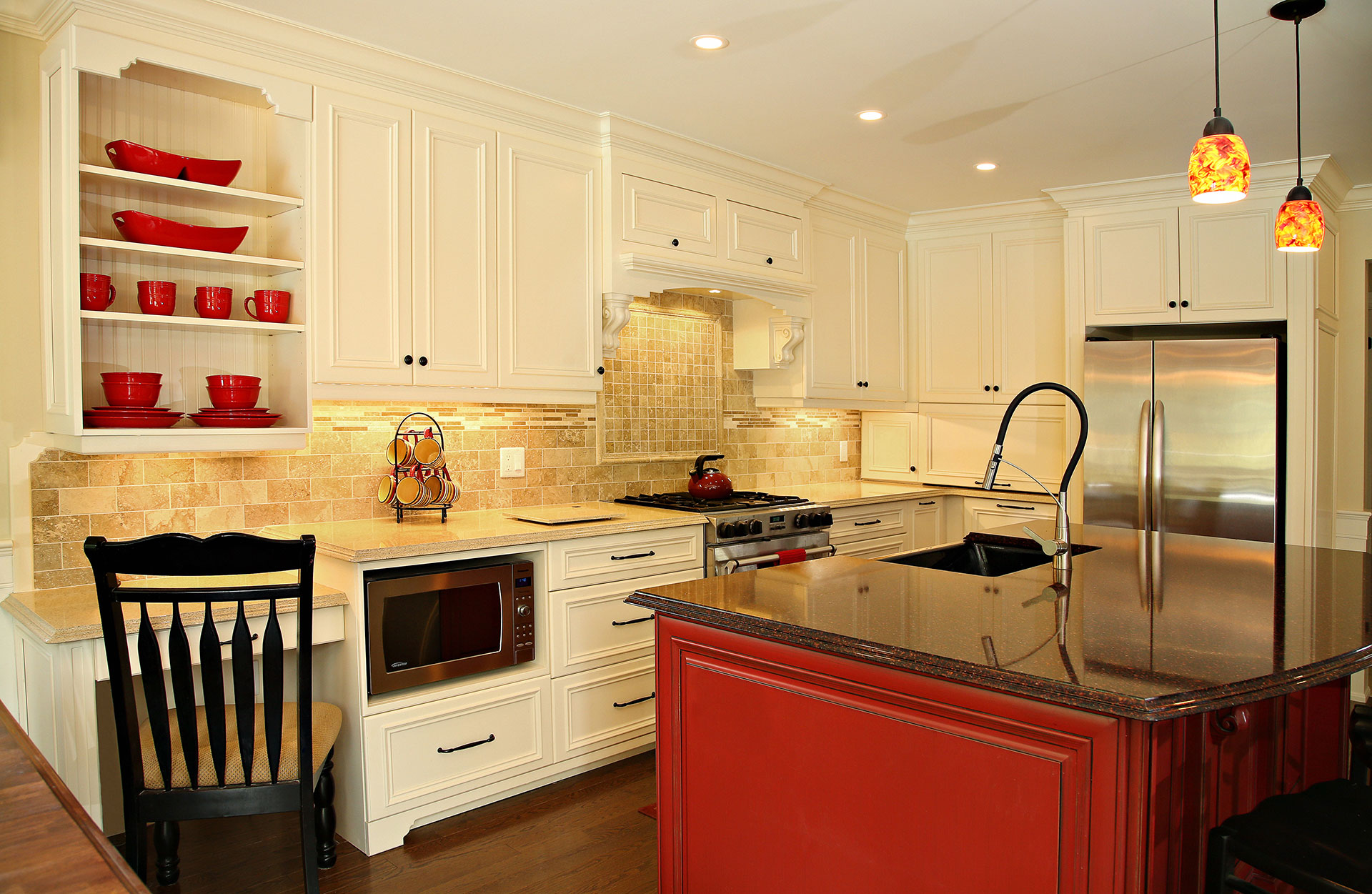 traditional kitchen, decorative rangehood, white cabinets, red island, microwave under counter wood floors in kitchens, Installation Services - Sheridan Interiors, sheridan interiors kitchens and baths, kitchen designer cornwall, kitchen designer ottawa, interior design cornwall, interior design ottawa