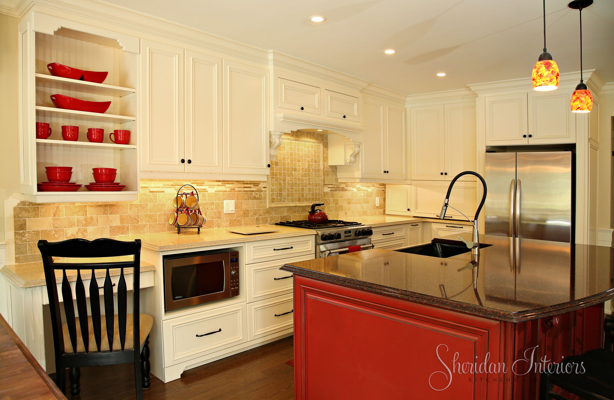 White Kitchen with red island and black stools