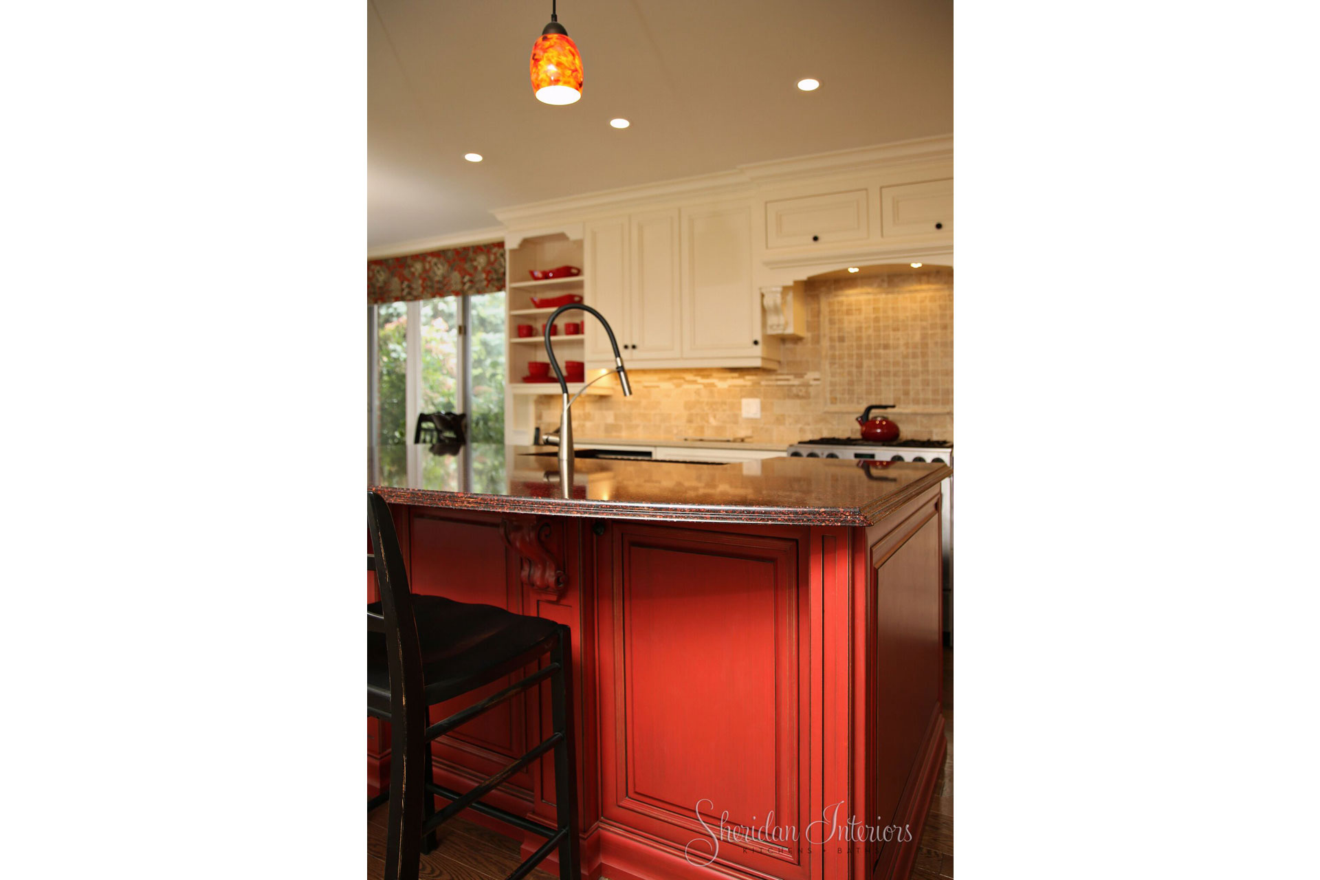 White Kitchen with Red Island and Black Stools - Sheridan interiors